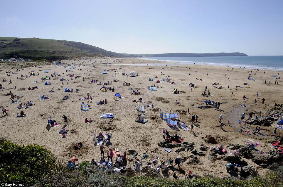 Hundreds of sunbathers caught the last of the sunshine at Woolacombe beach in Devon on Sunday as temperatures are expected to drop