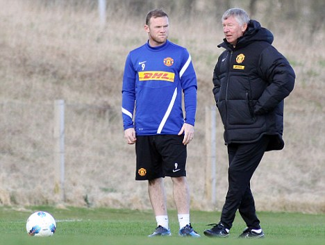 North of the border: Ferguson speaks with Rooney during training on Saturday