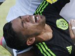 Hondurasí Luis Garrido, center, is injured as he fights for the ball against Mexicoís Javier Aquino, bottom, during a 2018 World Cup qualifying match in San Pedro Sula, Honduras, Tuesday, Nov. 17, 2015. (AP Photo/Fernando Antonio)
