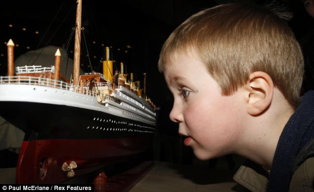 Oceans of time: Four-year-old Benjamine Greer looks at a model of the Titanic at the opening of the attraction dedicated to the tragic tale