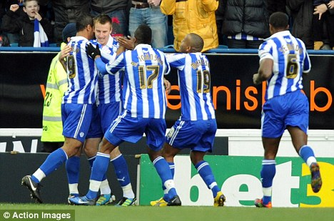 Flying high: Sheffield Wednesday celebrate as they see off Tranmere