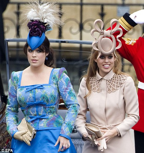 Princesses of York: Eugenie (L) and Beatrice (R) were flamboyantly dressed at the wedding ceremony of Prince William and Kate Middleton