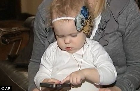Smart: 20-month-old London Hall, pictured, bought two $100 applications on her mother's iPhone after she was left to play with it