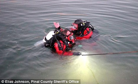 Recovered: Divers found the bodies near the bank where they had gone into the icy water