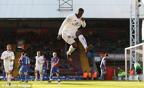 Jumping for joy: Sol Bamba scored what proved to be the winner as Leicester won for the first time in five games