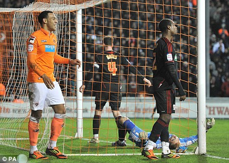 Own goal: Matt Phillips (left) celebrates after Seb Hines put into his own net