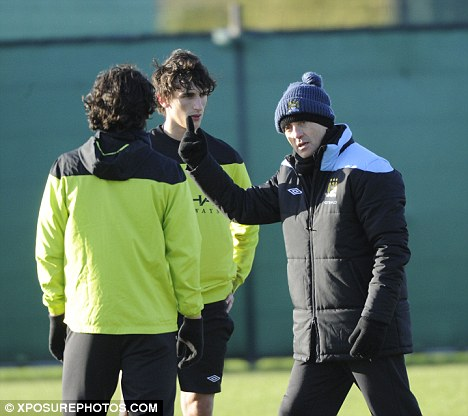 Making a point: Roberto Mancini lectures his players in training on Monday