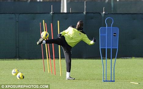 Close control: City striker Mario Balotelli shows off his skills at Carrington
