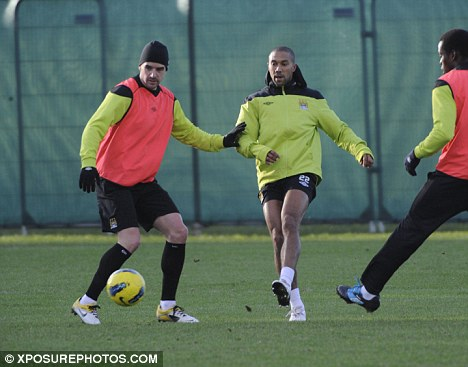 Hands off: Owen Hargreaves (left) keeps Gael Clichy away from the ball in training
