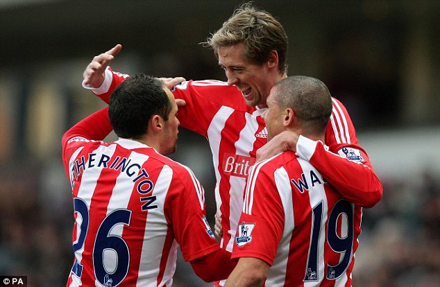 Towering talent: Crouch congratulated by Matthew Etherington (left) and Walters