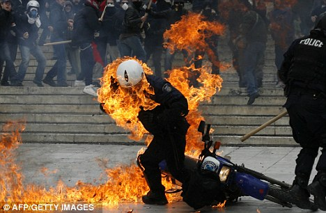 Harsh times: The Eurozone debt crisis has resulted in a number of countries introducing austerity measures. In Greece this resulted in violence on the streets