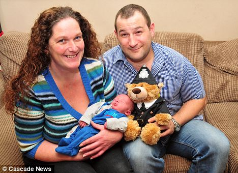 Martin Dunsford with his partner Toni and baby Phoenix with a PC teddy bear. They were helped by four police officers after Toni gave birth early