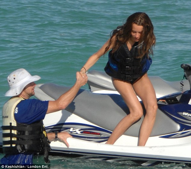 Easy does it! Jade had a helping hand as she made her way off the jet ski