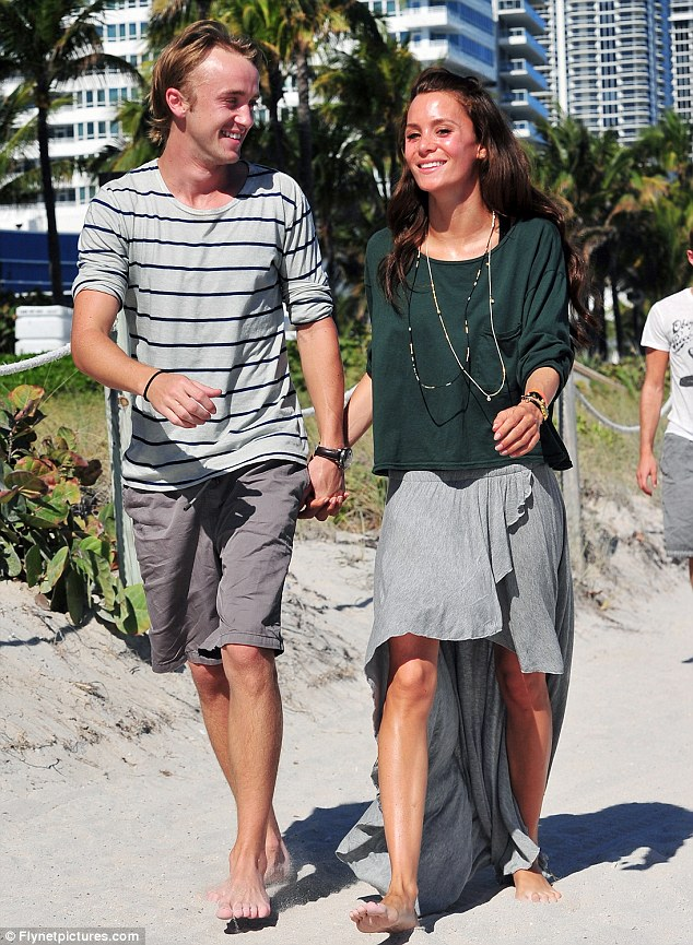 Laid-back style: The pair certainly knew how to work the barefoot beach look