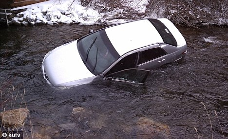 Close call: As many as 10 heroic people jumped into an icy Utah river to help save three trapped children after a car plunged down a 10-foot embankment and flipped over