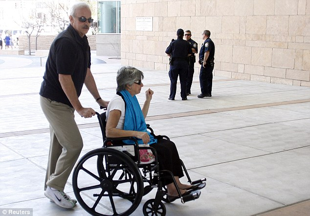 Survivor: Suzi Hileman is pushed in a wheelchair as she arrives at the U.S. Federal Court, where Tucson gunman Jared Loughner appeared for a status hearing