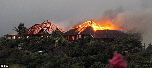 Destroyed: The couple were due to marry at Holly's father Richard Branson's £60 million Necker Island which was ravaged by fire in August