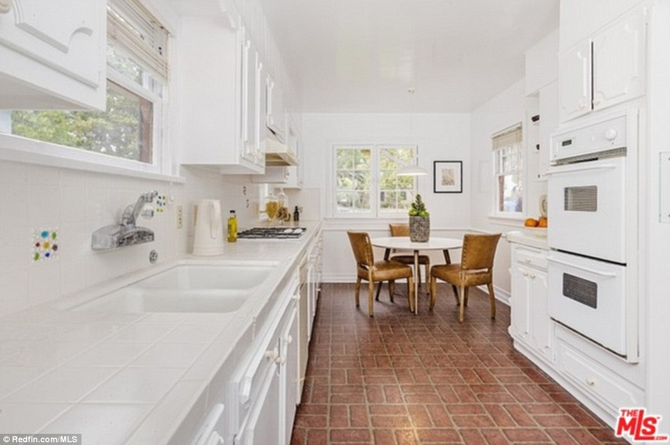 The bright kitchen also includes white appliances.The couple previously bought the 2,521-square-foot house in February for $2.711 million