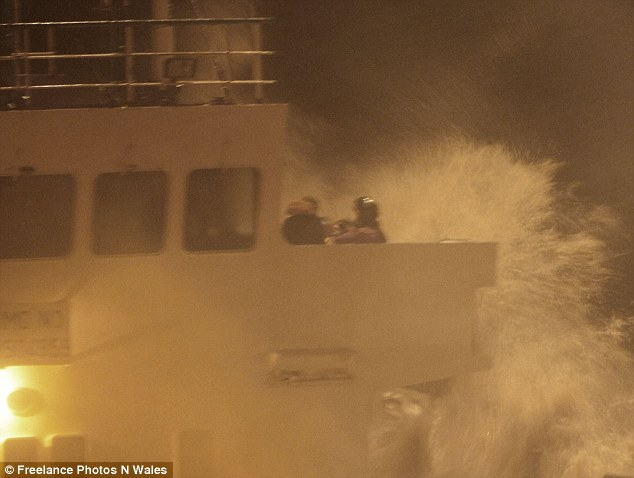 Rescue: RAF pilots flew over the ship and winched the crewmen to safety during the tumultuous weather