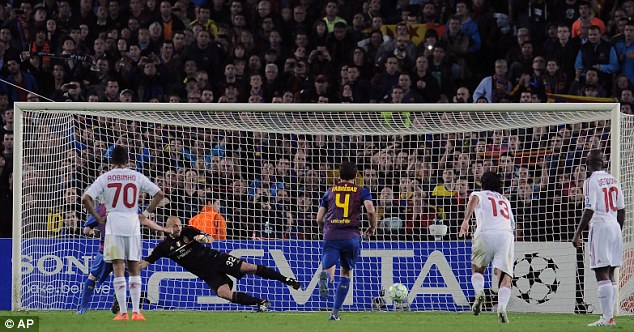 Spot on: Lionel Messi scored two first-half penalties to help Barcelona into the semi-finals