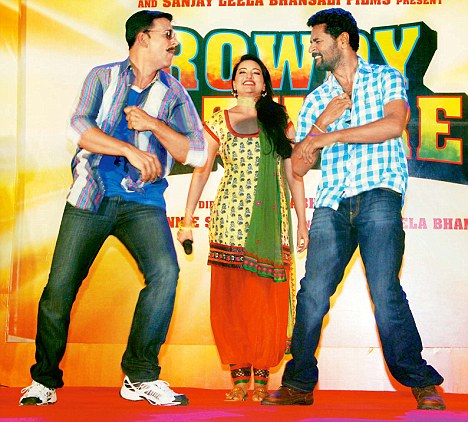 The director of Rowdy Rathore (pictured right) shakes a leg
