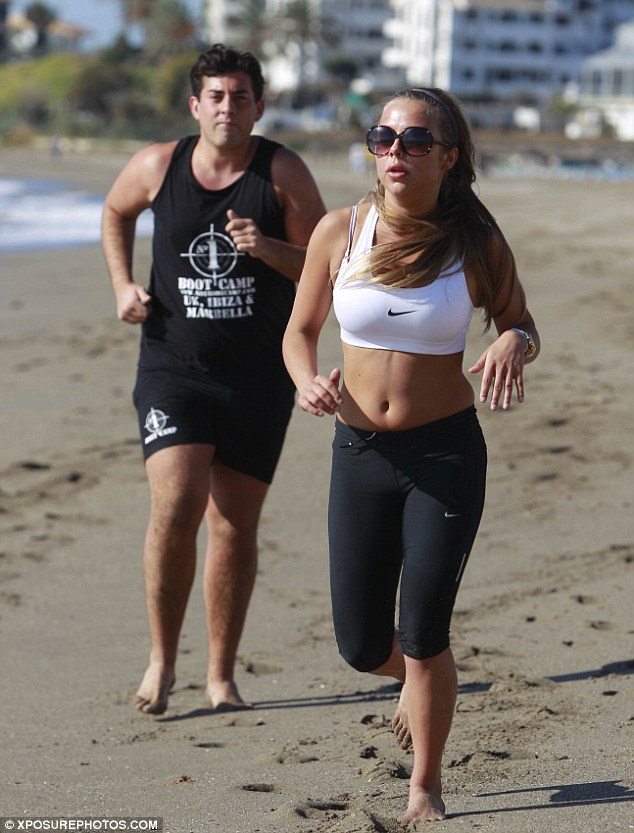 Fight the flab: Ellie worked out with Arg in Marbella, Spain, last month and hardly broke a sweat in her sunglasses