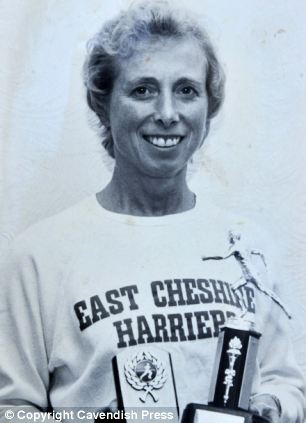 Muriel Brown with trophies won for East Cheshire Harriers