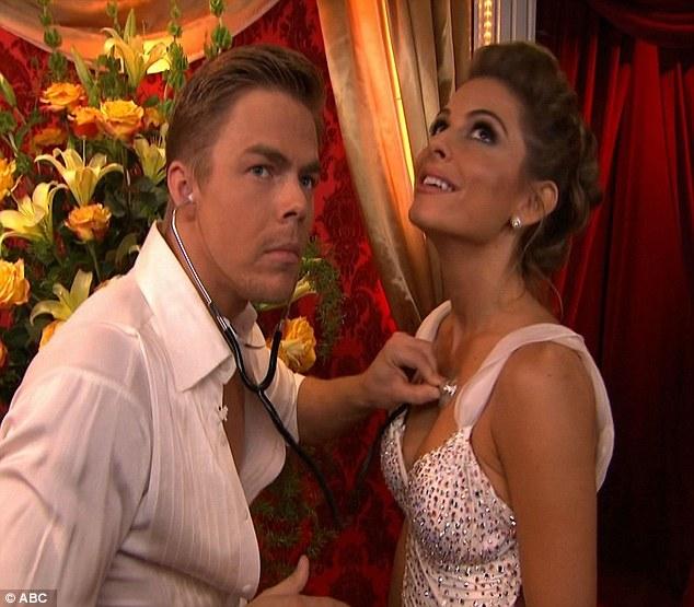 Heart skipped a beat: Derek jokingly listened to Maria's heart backstage