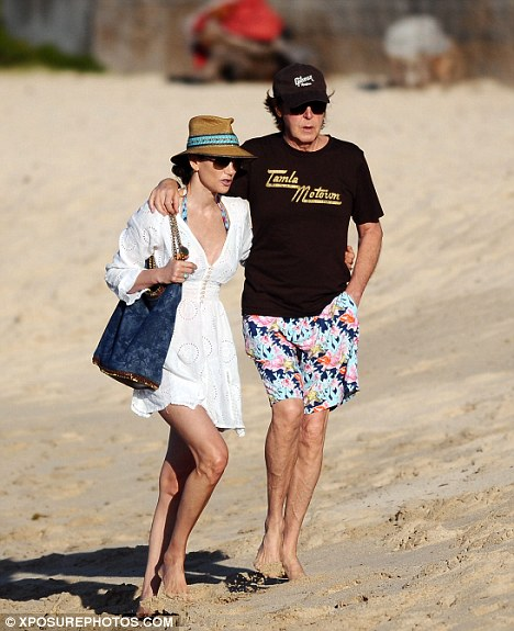 Happy couple: The newlyweds take a romantic stroll in St. Barts