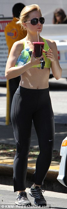 Post workout: The American Beauty actress supped on a healthy smoothie as she made her way back to her car