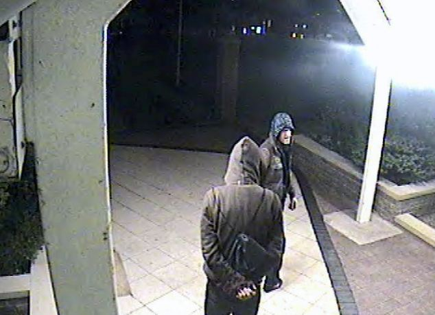 Grainy: The CCTV of the suspects lurking outside the woman's flat was captured at 3.04am on August 10 last year