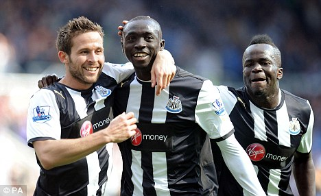 Ambition: Cheick Tiote (right) could stay at Newcastle if they make it into Europe