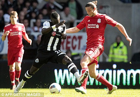 Combative: The powerful midfielder launches into a tackle