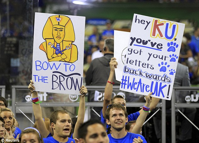 Cheering for the win: Kentucky Wildcats fans cheer against the Kansas Jayhawks in their men's NCAA Final Four championship college basketball game in New Orleans on Monday night