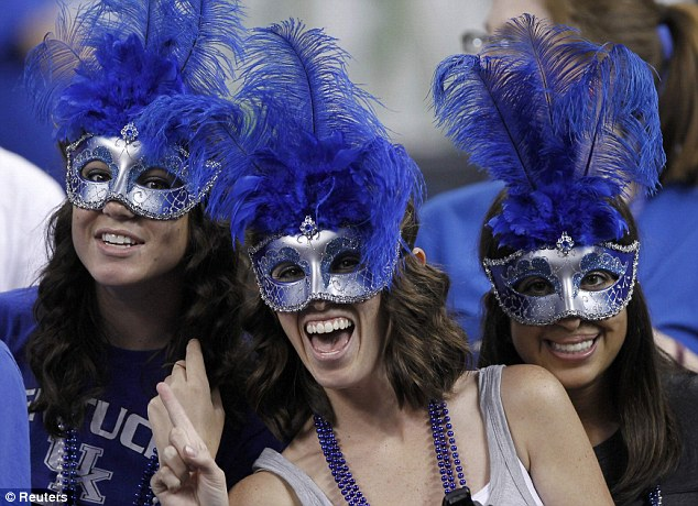 Game faces: Kentucky Wildcats fans wear silver and blue masks at the New Orleans match-up