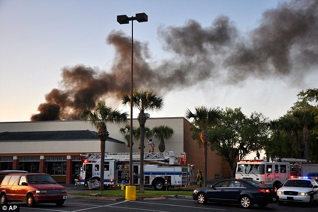 Explosion: The small plane spiraled out of the sky and into Northgate Shopping Center in Deland, Florida