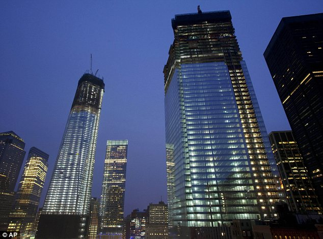 Landmarks: One World Trade Center, left, and Four World Trade Center, right, are the new development's flagship skyscrapers and are starting to dominate the New York skyline