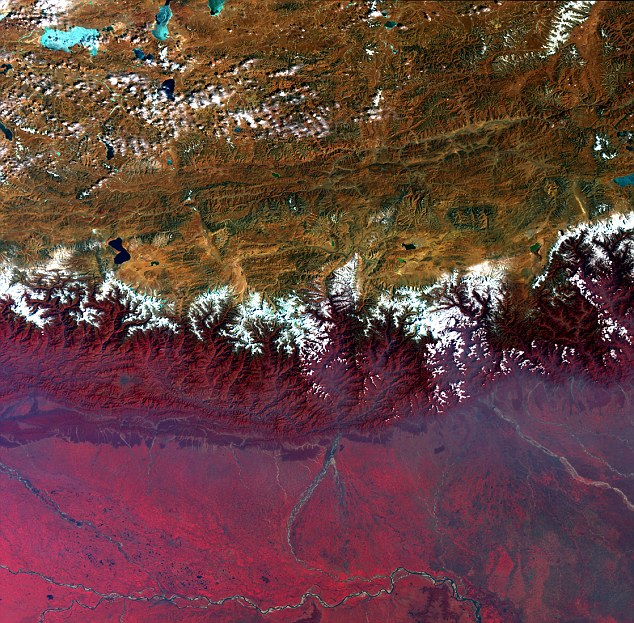 The Himalayas, as seen by Envisat:  Tthe barrier between the peaks of the Tibetan Plateau (top) in Central Asia and the plains of Nepal, Bhutan and India in the Indian subcontinent. In this false-color image, lush or green vegetation appears bright red