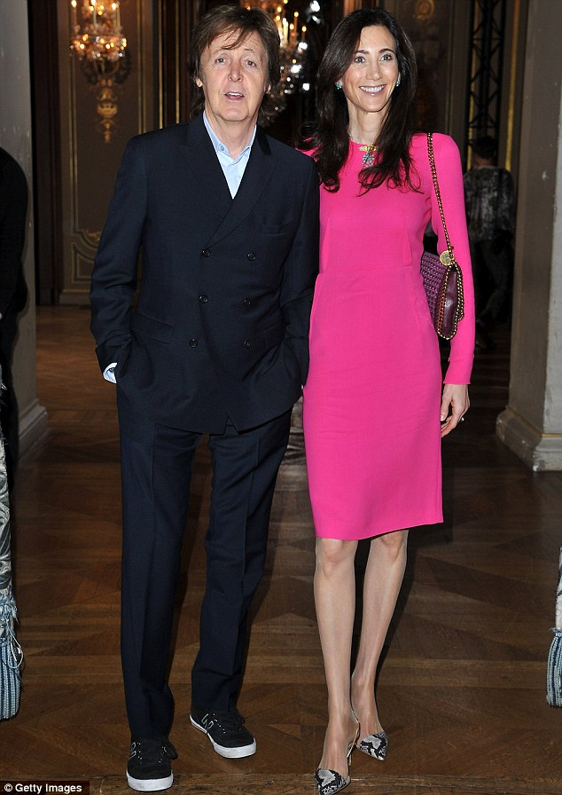 Taking centre stage: Sir Paul McCartney let wife Nancy Shevell shine in a hot pink dress at his daughter Stella's fashion show in Paris, France, today
