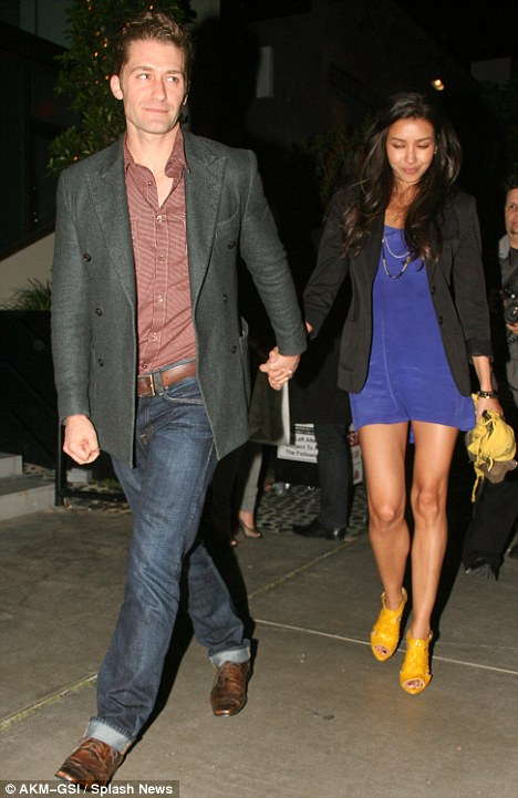 Me and my girl: Matthew didn't want to let go of his stunning girlfriend's hand as they headed home