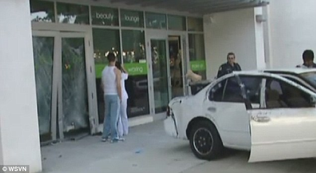 Surprise: The owner of a nail salon in Miami woke to news that a car had smashed into her business with the drivers carrying away her ATM