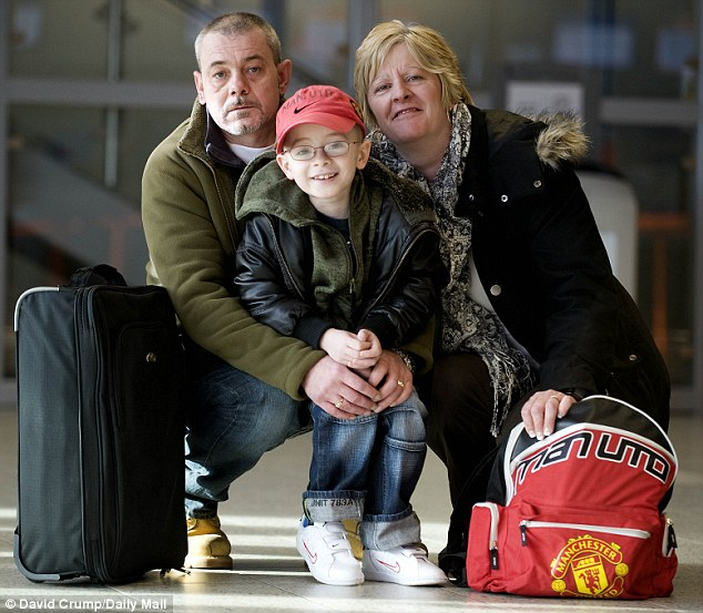 No other option: Zac, pictured centre with his parents, Bob Smith left, and Sam Knighton, right who are taking him abroad for a lifesaving operation