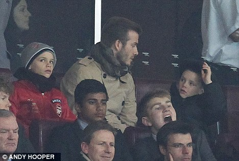 Paying a visit: David Beckham in the crowd with his family
