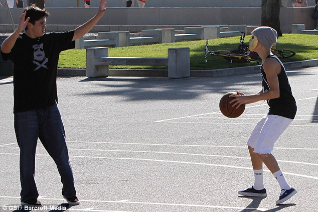 Work it out: Justin spent time playing basketball
