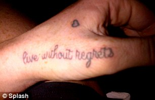No regrets: The sometime actress had the ink added to her left hand