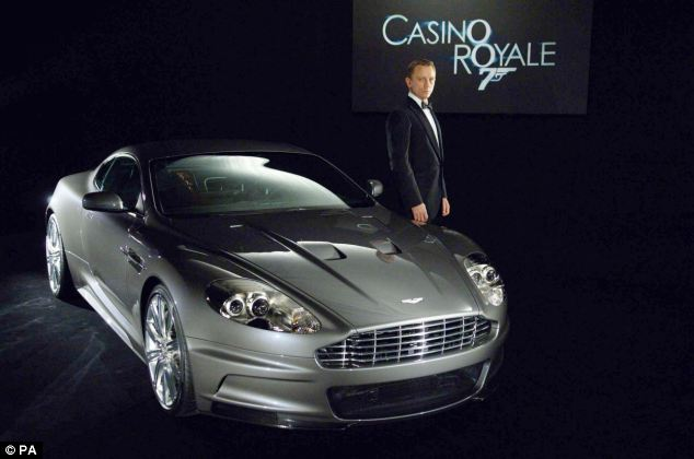 Worthy of the silver screen? The new Mondeo has been compared to an Aston Martin (the DBS is pictured here with Bond star Daniel Craig)
