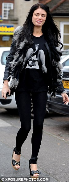 Still in style: The star didn't let her fashion sense down though, sporting a fur jacket, leggings and a pair of wedges