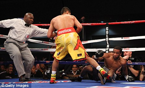 Controversy: Amir Khan knocked Lamont Peterson to the ground in the first round, but was crucially docked two points for holding