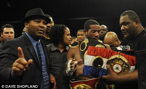 Out in the open: Exactly what was Mustafa Ameen (left) doing in the front row next to fight supervisor Michael Welsh?