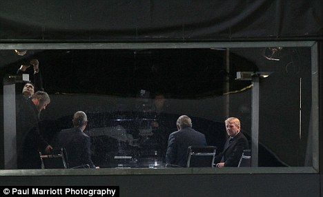 I'm up here: Gordon Strachan (right) looks down on the action at Peterborough